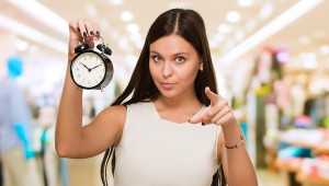 dailyweighin-Young-Woman-Holding-Clock-And-41990395